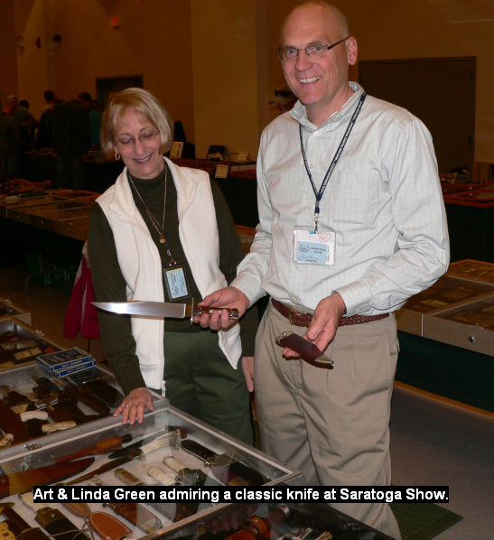 Art & Linda Green admiring a classic knife at the Saratoga Show.