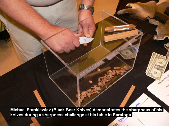 Michael Stankiewicz (Black Bear Knives) demonstrates the sharpness of his knives during a sharpness challenge at his table in Saratoga.