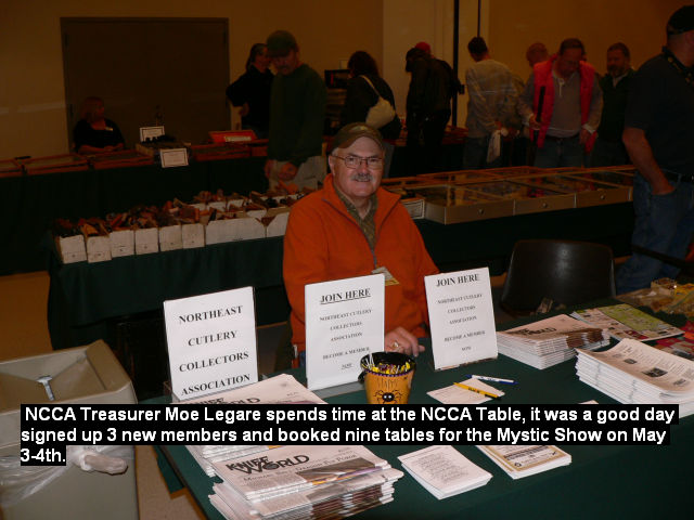 NCCA Treasurer Moe Legare spends time at the NCCA Table.