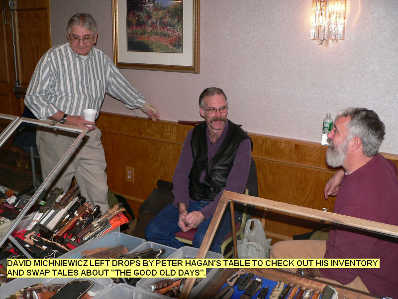David Michniewicz left drops by Peter Hagan's table to check out his inventory and swap tales about THE GOOD OLD DAYS.