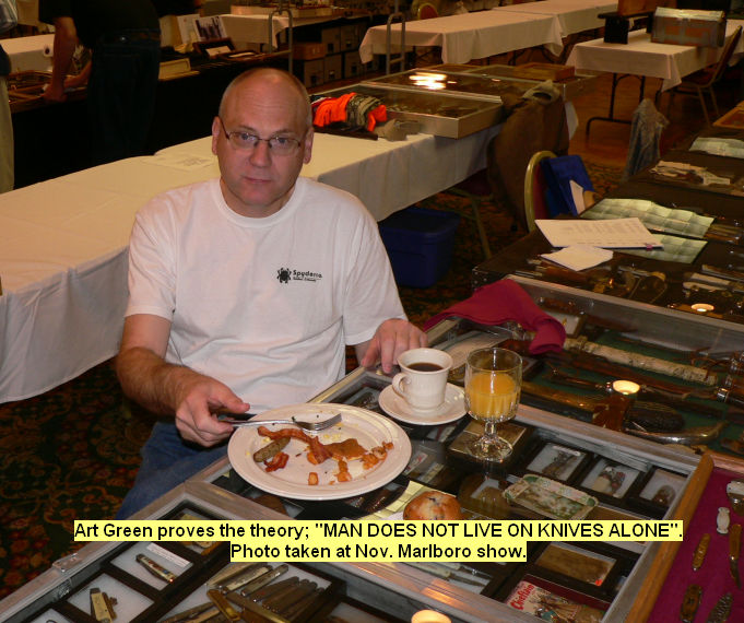 Art Green proves the theory; MAN DOES NOT LIVE ON KNIVES ALONE. photo taken at Nov. Marlboro show.