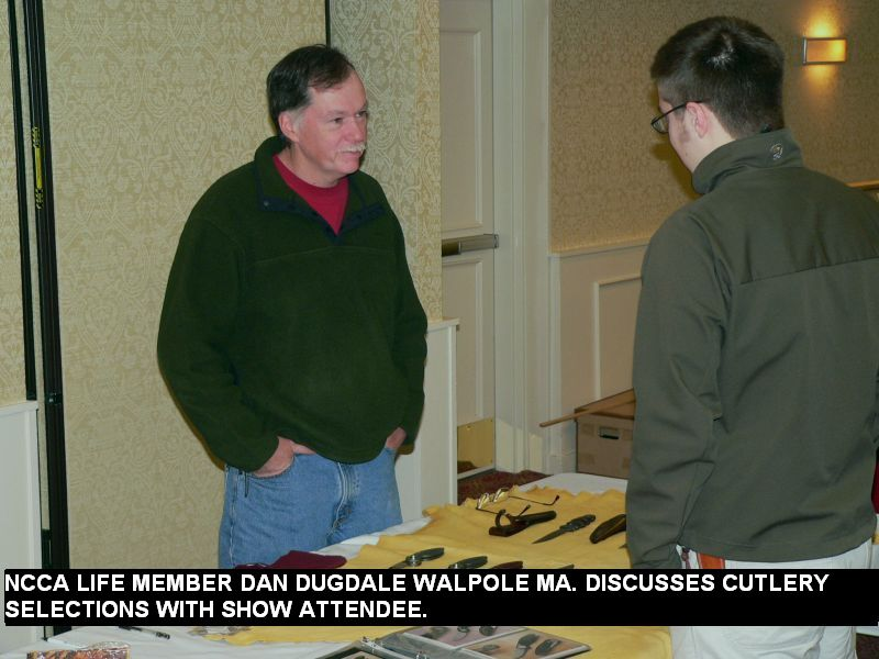 NCCA Life member Dan Dugdale Walpole MA discuses cutlery selections with show attendee.