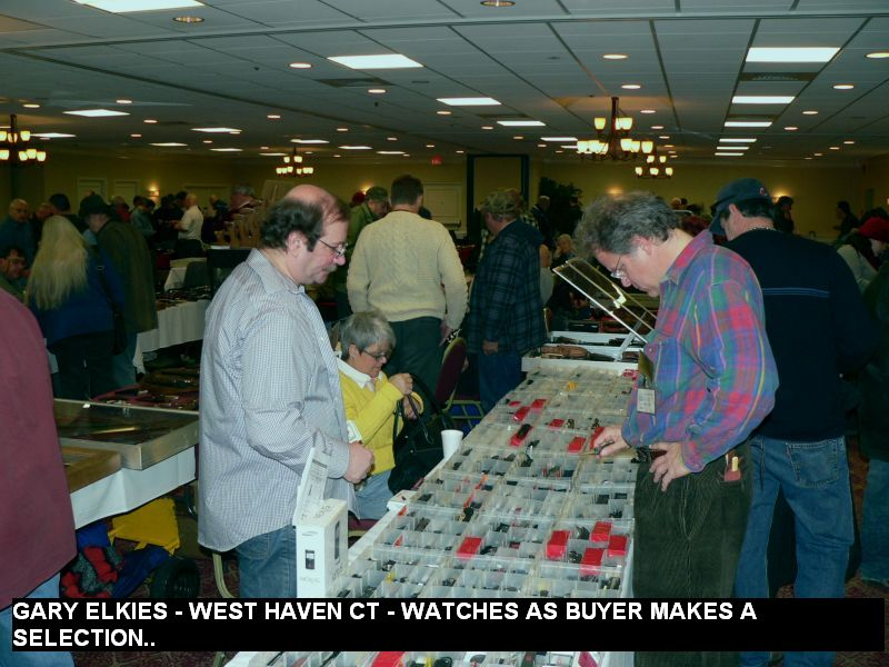 Gary Elkies - West Haven CT - watches as buyer makes a selection..