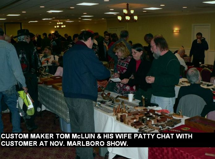 Customer maker Tom McLuin & his wife Patty chat with customer at Nov. Marlboro show.