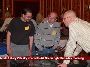 Mark & Gary Zalesky chat with Art Green right Saturday morning.