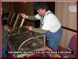 TOM MARINO HELPING A COLLECTOR MAKE A DECISION.