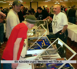 ED AZEDEH (right) MINDING HIS TABLE.